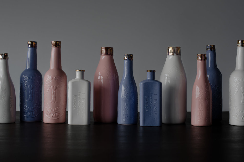HOMEGROWN COLLECTION - This range celebrates local historic industry, in which Rebecca creates moulds from beautiful antique bottles from industries that are no longer in existence. 'This collection is continually growing as I am always on the look out for beautifully textured bottles from around Ireland that give us a glimpse into industries of the past'. The quirky bottles in millennial pink, white and dusky blue aim to bring a fresh approach to nostalgic bone china.
