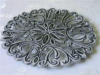 You can find this metal trivet HERE.