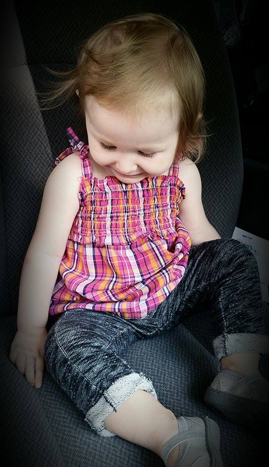 - Bentlie thought it was so fun to sit in the front seat waiting on dad to go! The photo below was taken a couple of months ago! She can still wear this outfit with ease :). I think the mismatched socks she touch was just perfect!