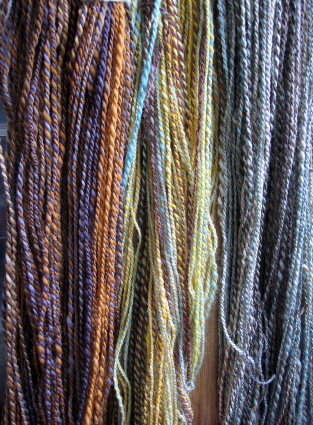 "From left to right: Southern Cross FIber South African Merino/Corriedale in ""Buccaneer"", Hello Yarn BFL in ""Scorch"" and Hello Yarn Panda in ""Villain"""
