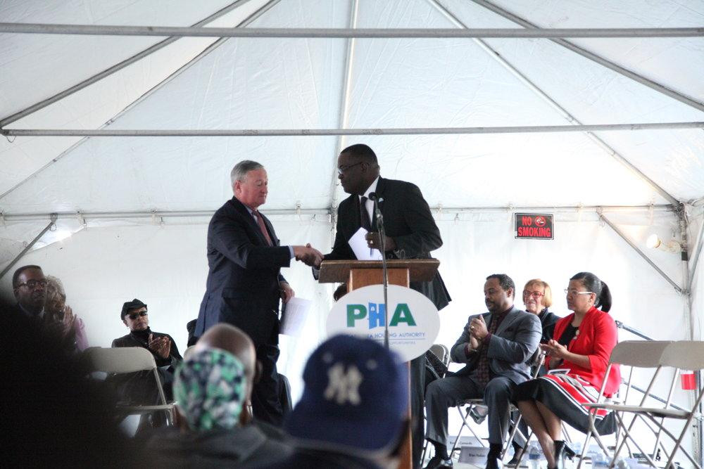Mayor Jim Kenney shakes hands with PHA President & CEO, Kelvin Jeremiah