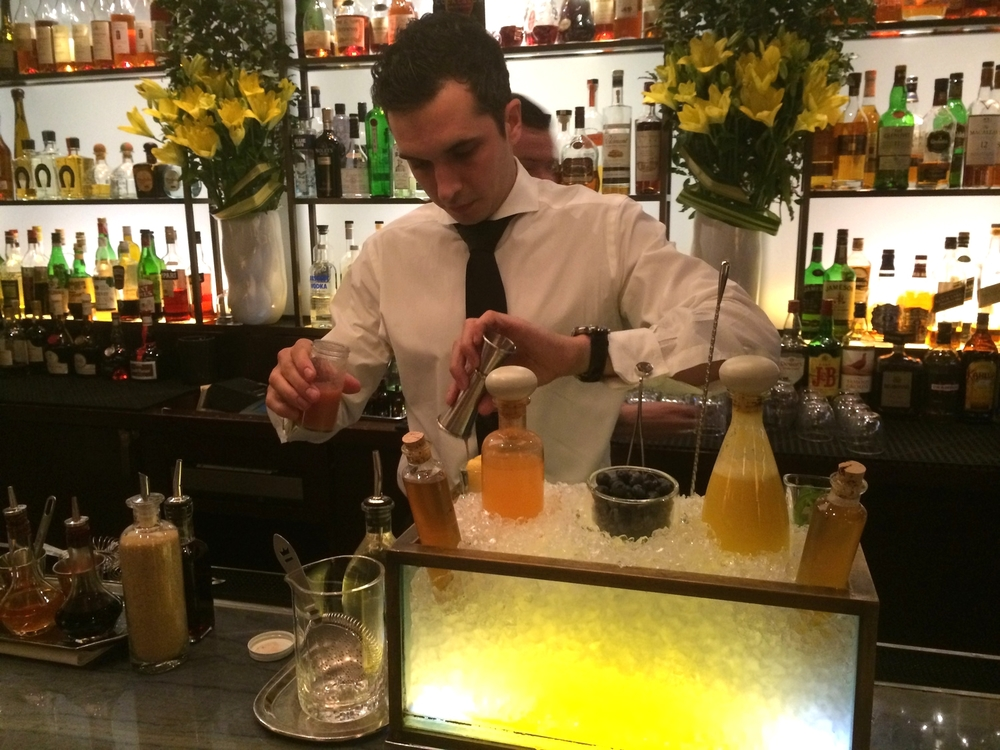 Head Barman at Daniel mixing up a drink using Lady Lychee.