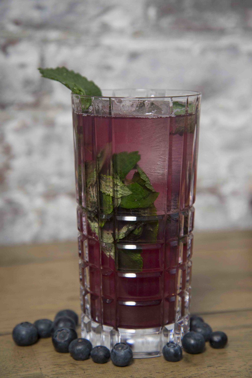 Blueberry Mojito 1.0 Blueberry Finn 2.0 oz white rum 1.0 oz mint infused simple syrup 1.0 oz lime juice 2.0 oz soda water (Recipe by Jeff Turok)