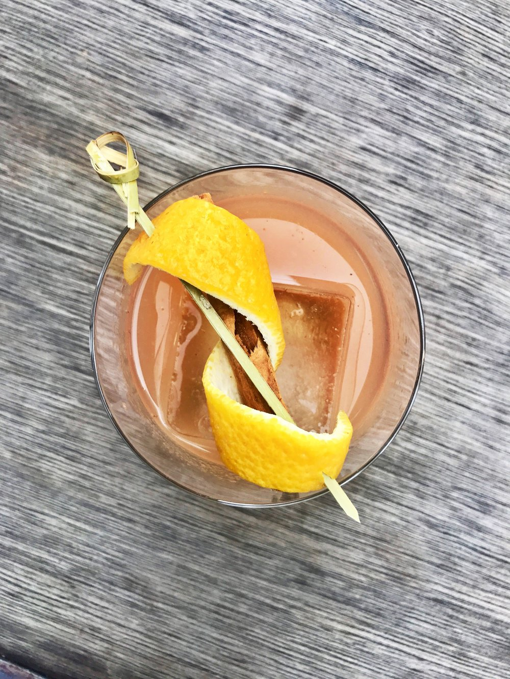 The Whiskey Fritter   1.0 oz. Louis Applestrong 0.5 oz. Johnny Pumpkinseed 1.5 oz.Bulleit Bourbon Pinch of ground nutmeg  (Recipe by Allison Torres, Head Bartender of the Refinery Rooftop Hotel)