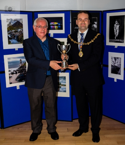 John Gilmore receiving his Trophy from Provost McAllister.
