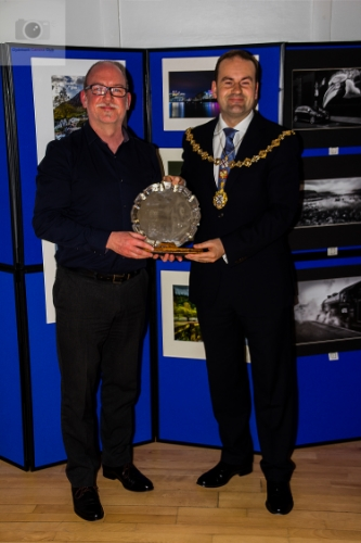 Kevin Thomas receives his salver from Provost McAllister