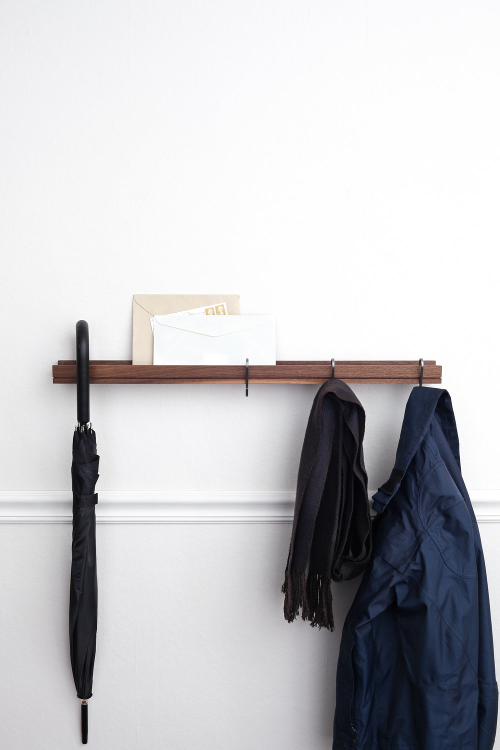 SINGULAR cantilever wall shelf used as a coatrack entry or foyer shelf