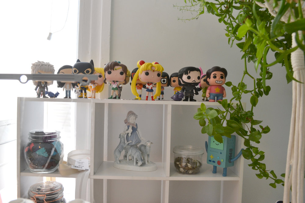 My Funko Pops keep falling off this shelf when I serge, so I'm going to have to find a new place to put them soon! I also collect weird lamb ceramics (to the dismay of my very utilitarian boyfriend)