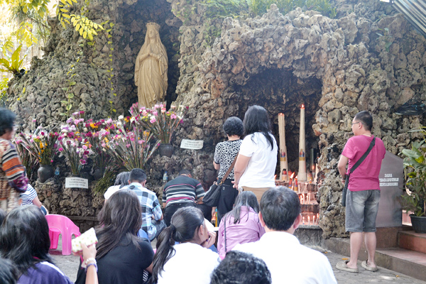 praying to mary shrine in indonesia.jpg