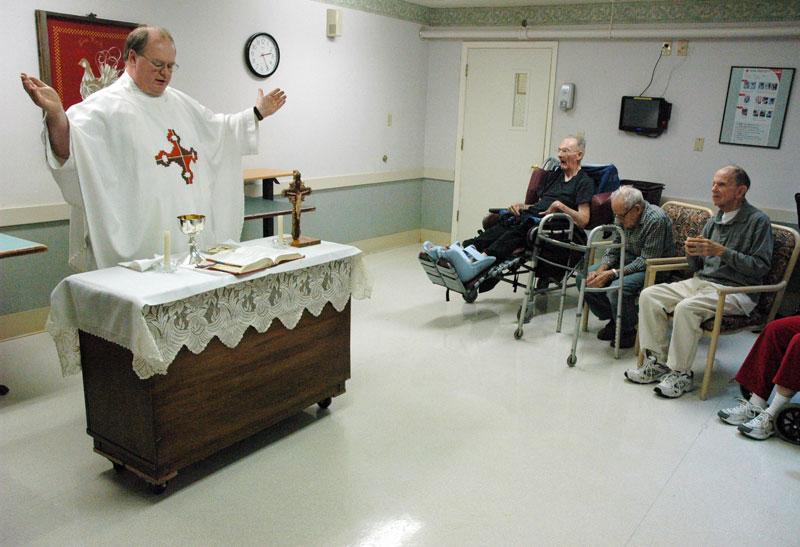 priest celebrating mass at nursing home.jpg
