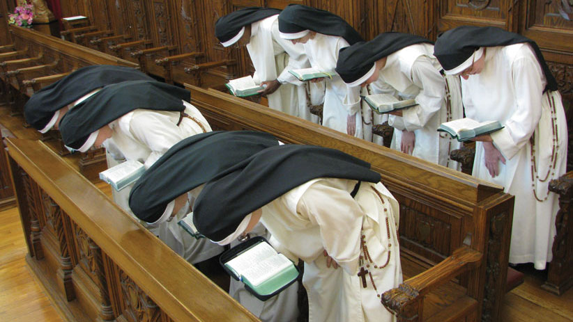 nuns with rosary bowing.jpg