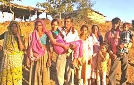 Kapila being carried by her dad surrounded by her family