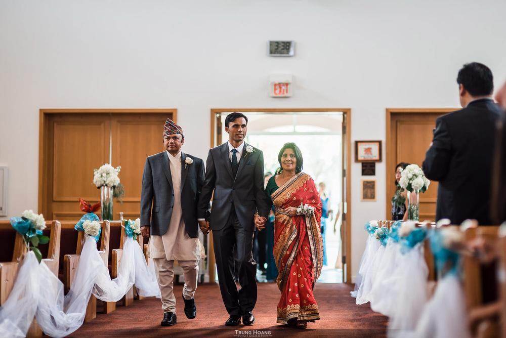13-groom-walking-down-aisle-with-parents.jpg