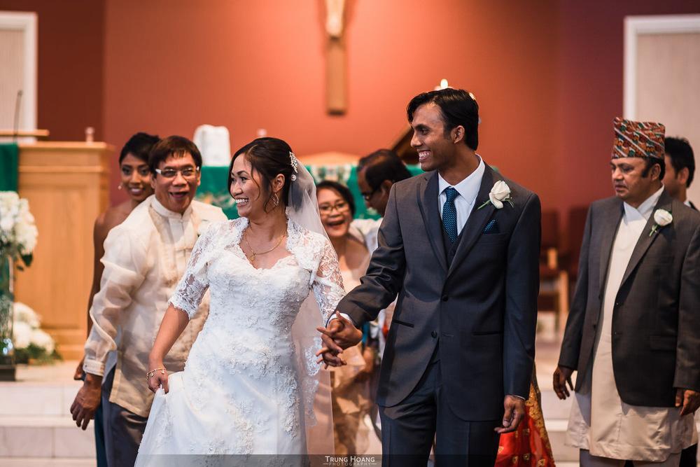 24-bride-and-groom-walk-down-aisle.jpg