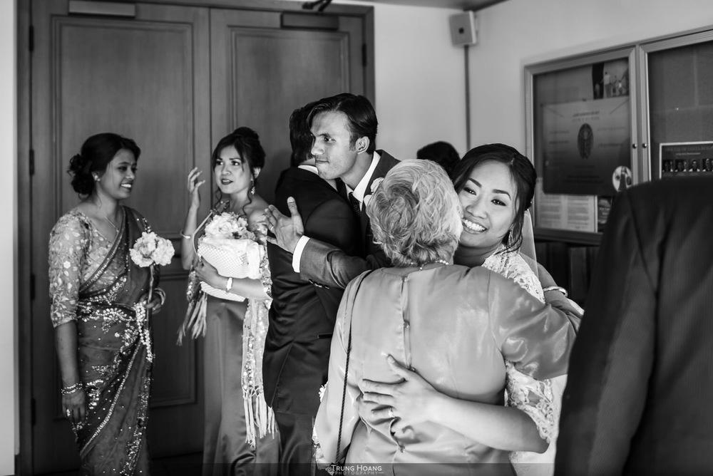 28-bride-and-groom-hug-parents.jpg