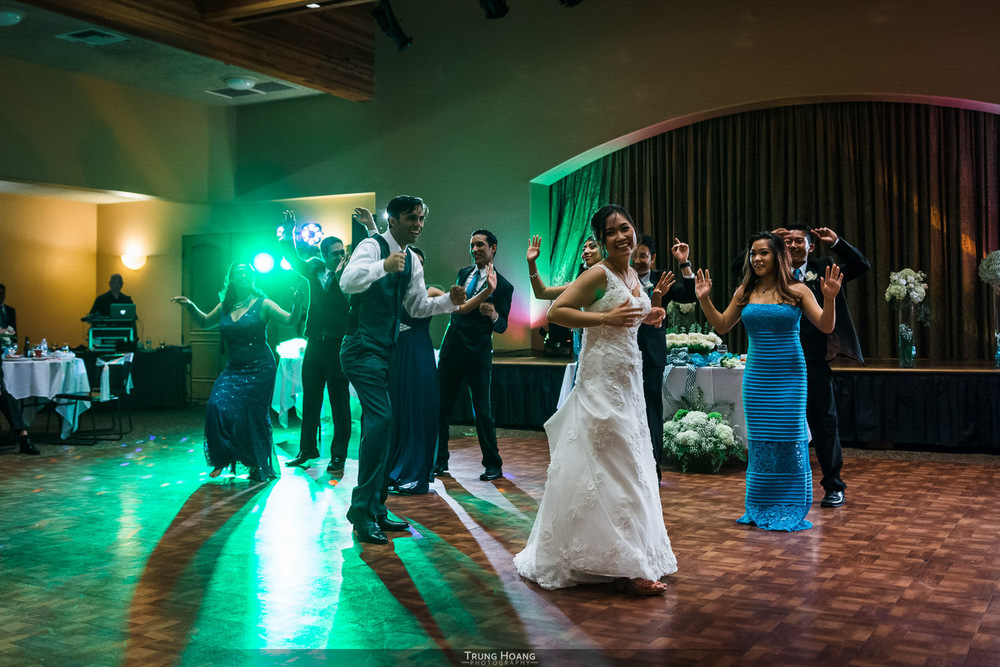 56-bride-and-groom-dancing-with-wedding-party.jpg