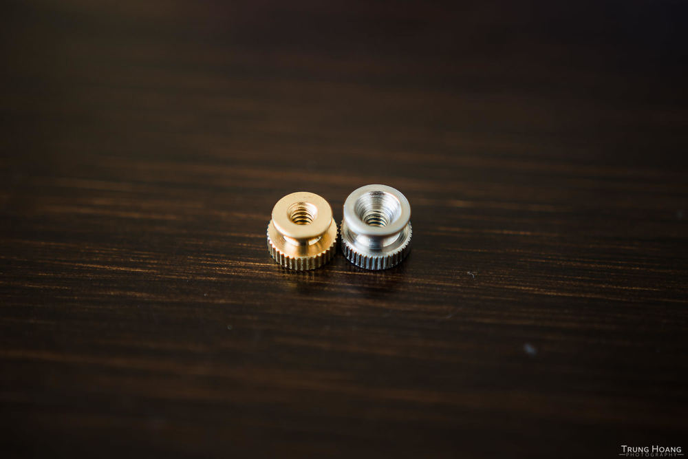 6-32 knurled nuts in brass (left) and stainless steel (right).  The stainless steel one allows the insert to sit deeper in the nut