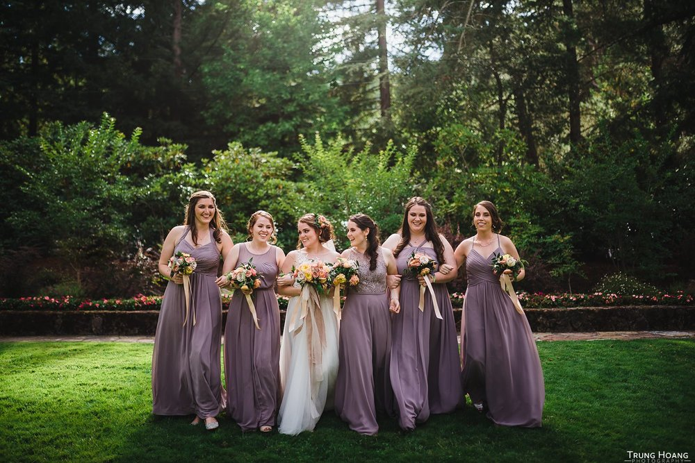 Bridesmaids linking arms photo