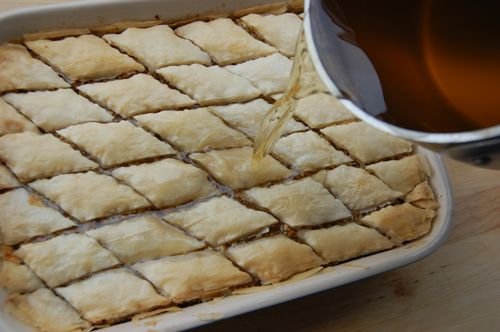 baklava pouring on the syrup.jpg