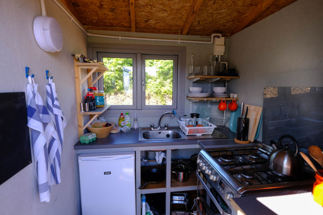 Kitchen, with fridge and full size cooker, has all the pots, pans and other equipment you need to cook.