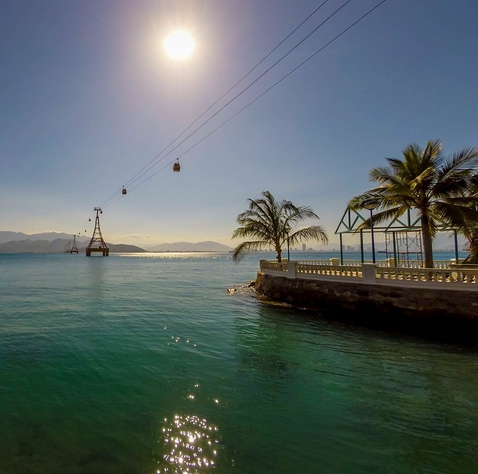 """View of the Nha Trang from Vinh Nguyen Island. The cable cars take you from the mainland onto Vinh Nguyan Island where there is a huge waterpark and resorts. If you look closely, you can see Nha Trang's skyline in the distance"""