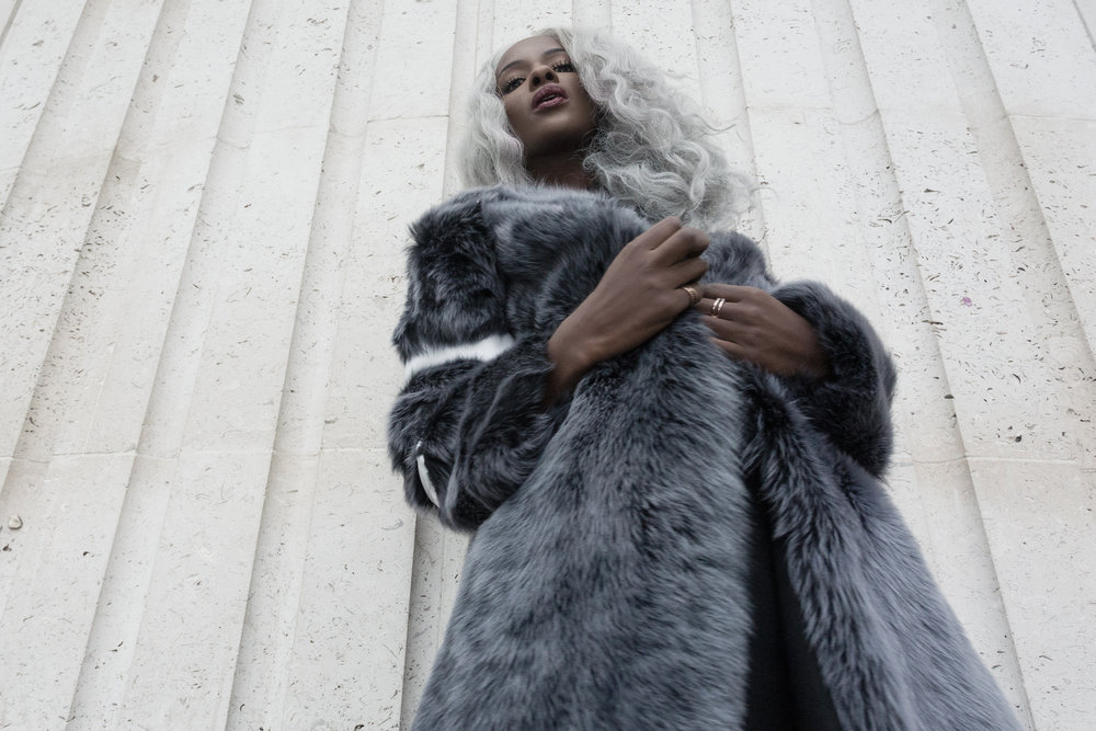 Sarah Mulinda wearing The 7962's Sandrine Fur Coat and Katerina Gown