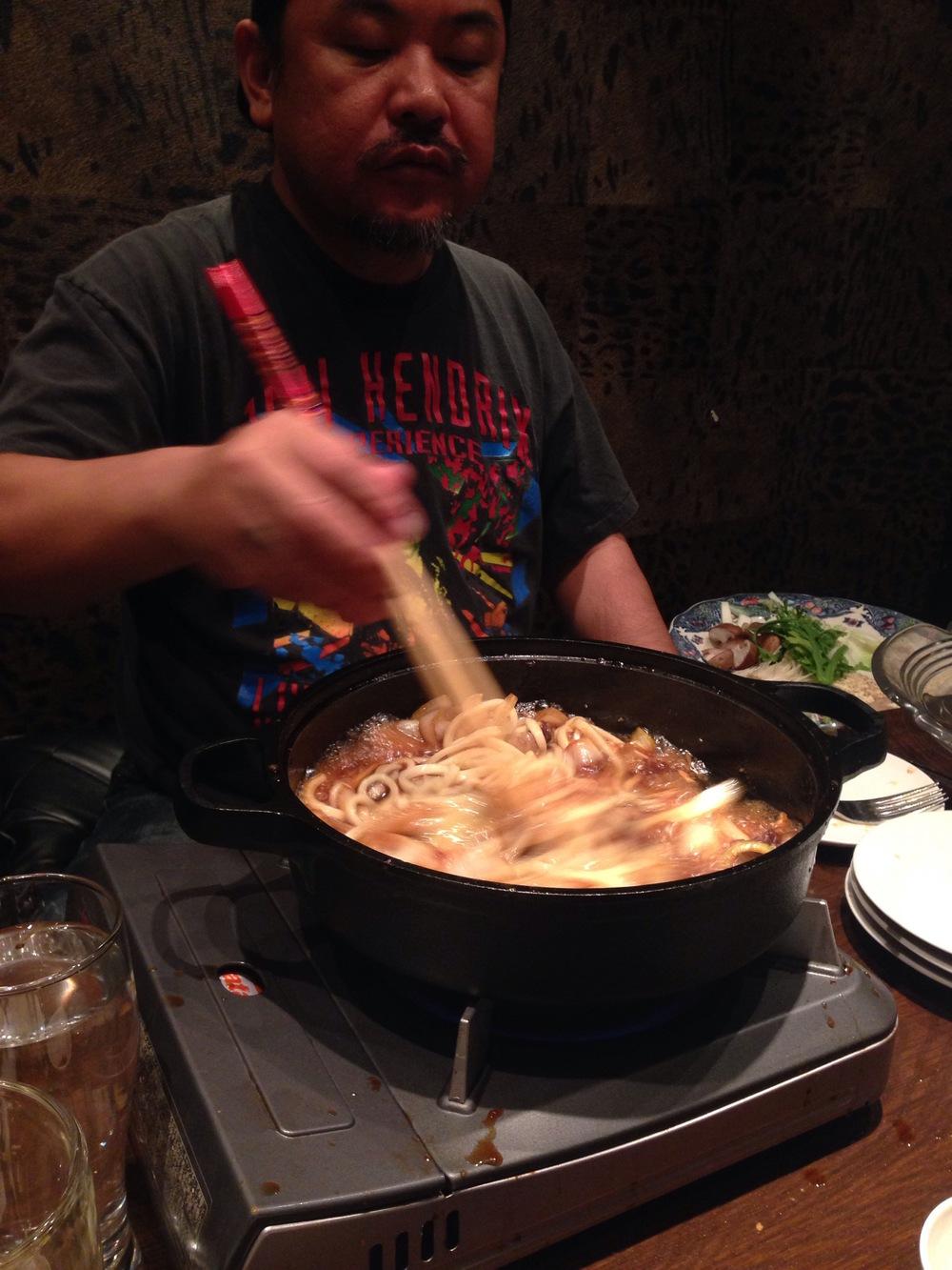 Seiji prepares sukiyaki