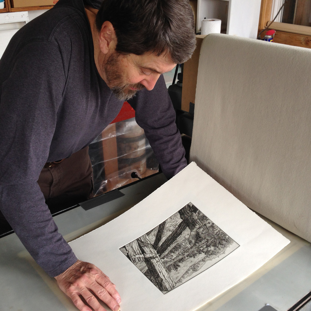 Roger Bailey inspects one of the prints pulled for the edition.