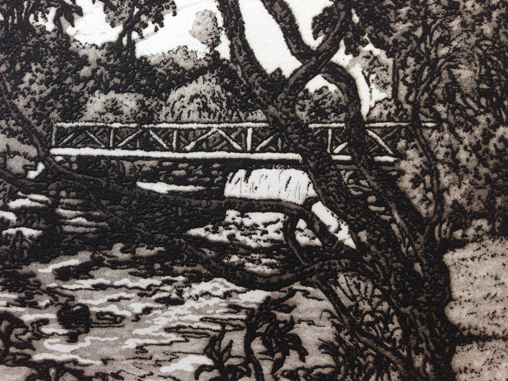 This detail from a finished print shows the complex intaglio processes as it depicts the wooden bridge leading from the house and studio across the creek to the rock formations and hills beyond.