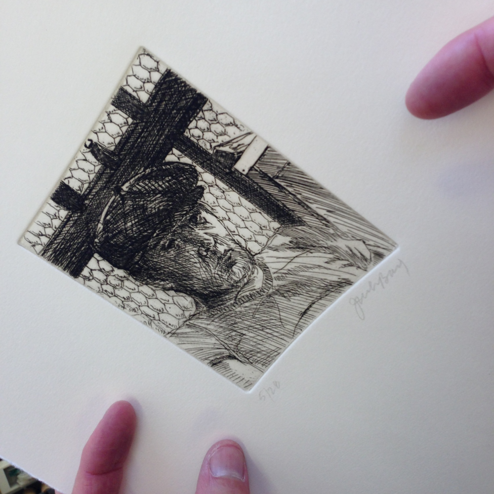 Examining one of the prints from the edition.