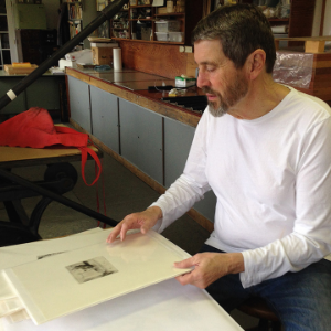 "Roger Bailey looks through some of the Jack Beal ""bon à tirer"" proofs. These ""good to print"" proofs were designated by Jack as the standard for print quality for each print in an edition and traditionally are a gift from the artist to the printer."