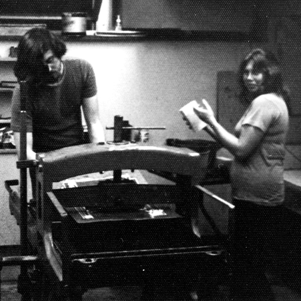 Working in the print room at St. Lawrence University, printer Roger Bailey prepares to pull an impression while Sondra Freckelton stands by ready to re-dampen the stone.
