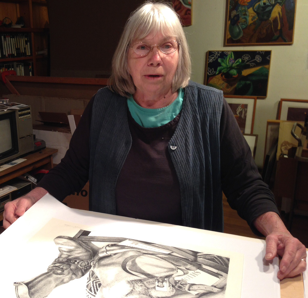 Sondra examining one of the prints from the edition.