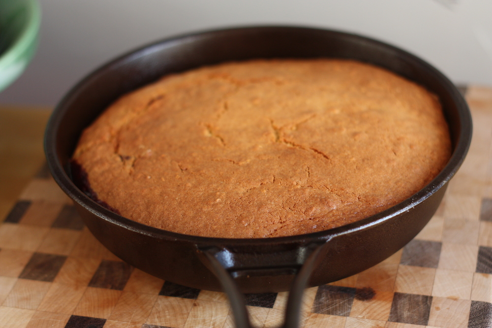After pouring the batter over the fruit, the cake is baked in the oven...