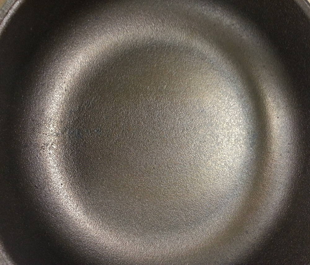 A closer look at the AUSfonte sanded cooking surface. Note: don't worry if you see small pin holes - they do not affect cooking or hygiene. This is real cast iron, not pressed smooth iron sheet or enamel-coated cast iron (which fills the normal pinholes in other brands), and it's not Teflon coated. It's pure natural, non-toxic, hand-smoothed cast iron with personality. Embrace it.
