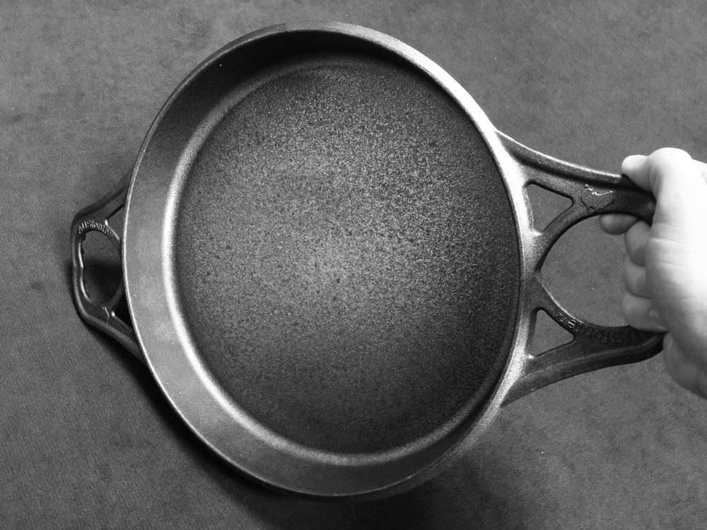 The Love Handle touches down on the bench/stove early in the lift, so the pan can be raised high over a plate or tray with very little lifting effort. The wide handle allows for a strong grip for lifting/twisting.   SOLID  Aussie engineering innovation!