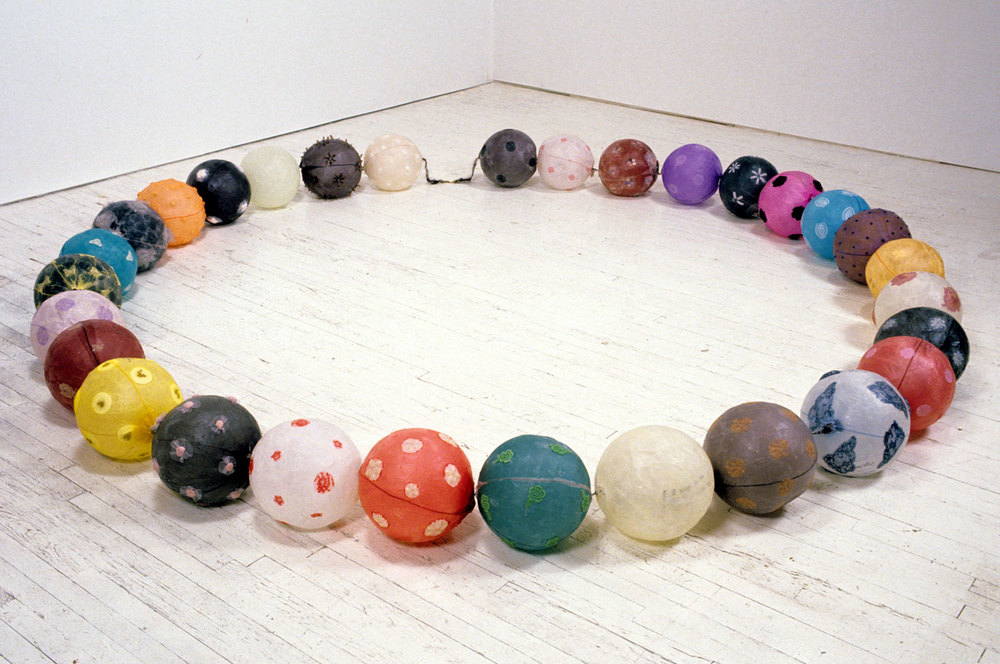 1997, 10'x10'x1', Installation: wish paper, fabric, nylon, feather, lace, beans, rice, metal, plastic, hair wax, etc.