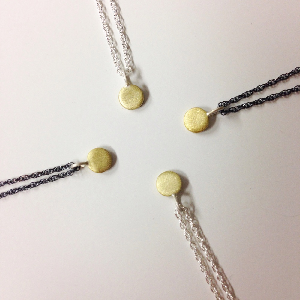 Itty bitty brass necklaces  add some golden sunshine up your day.