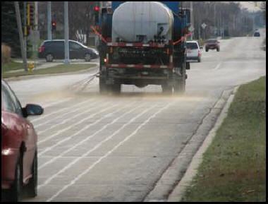 A truck applies salt brine to a road prior to a storm, a practice that can reduce the amount of salt used to keep roads open. (photo courtesy of the Village of Hanover Park)