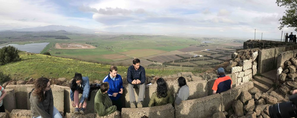 Tour guide Nathan Landau explaining the history of the Syrian civil war. This is looking east from the Golan Heights. Syria is in the background.