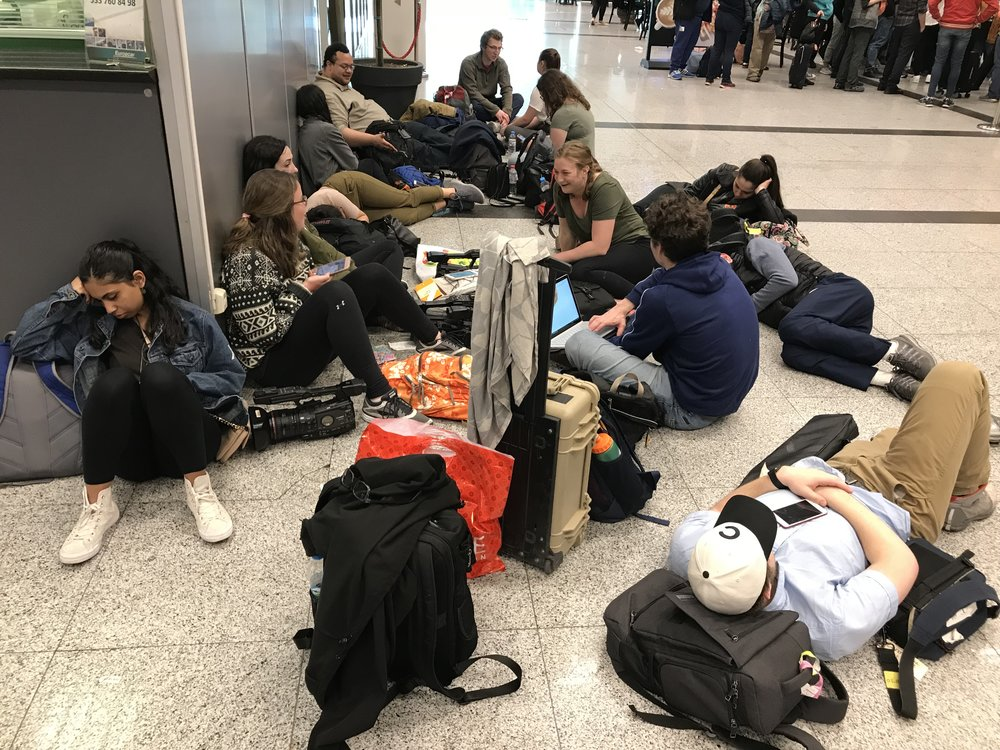 Newhouse students waiting at the Istanbul Airport for a flight home to Syracuse.