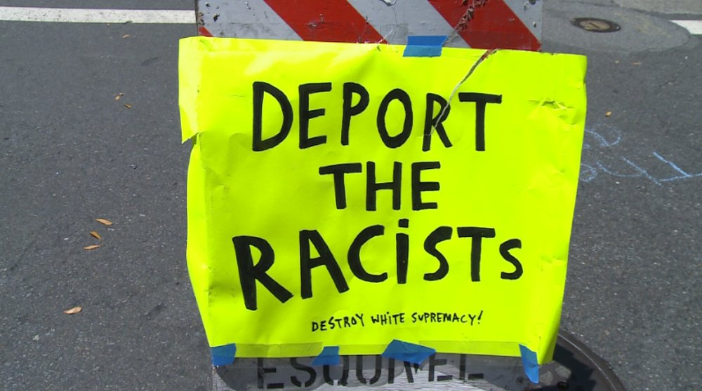 deport the racists sign.jpg