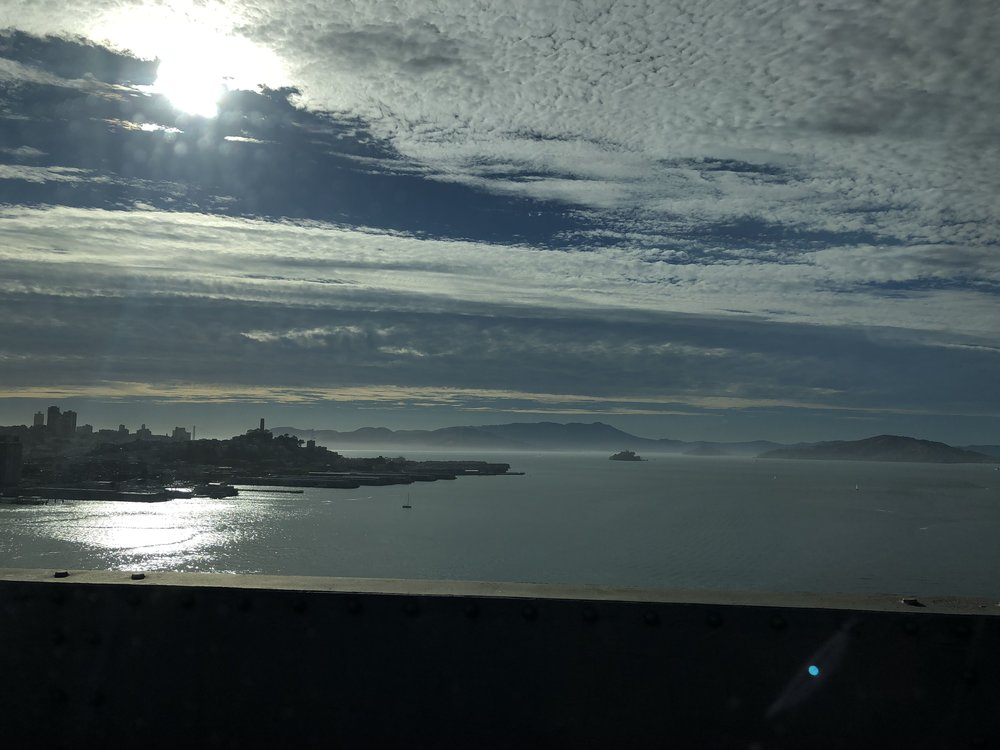 The sun goes down over Alcatraz and the San Francisco Bay.