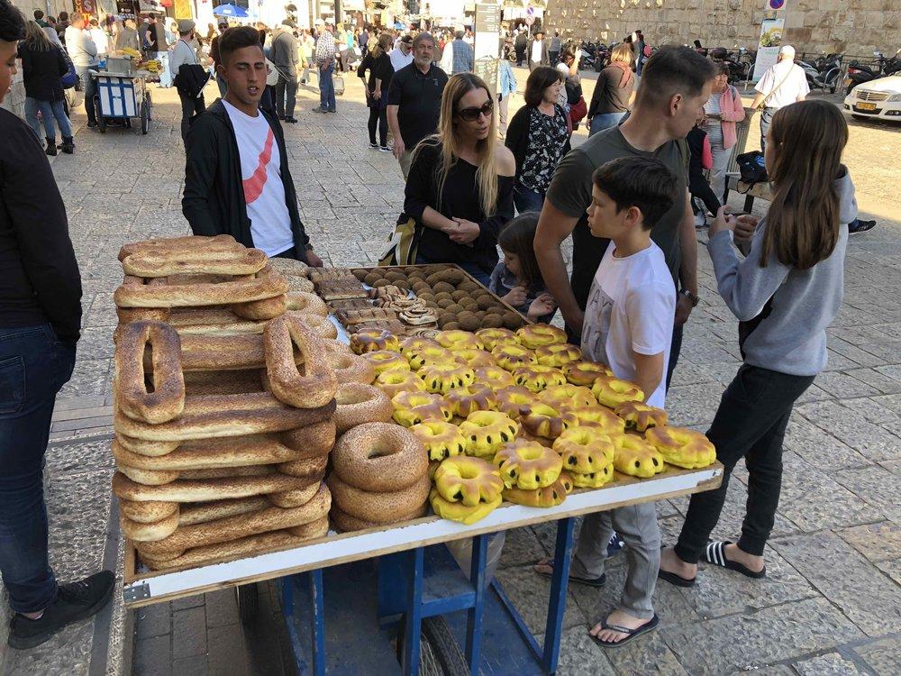 Bartering for beautiful bread in historic Jerusalem.