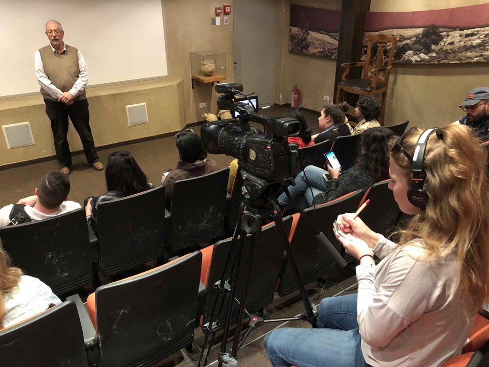 Newhouse students reporting during a talk by Yisrael Medad.