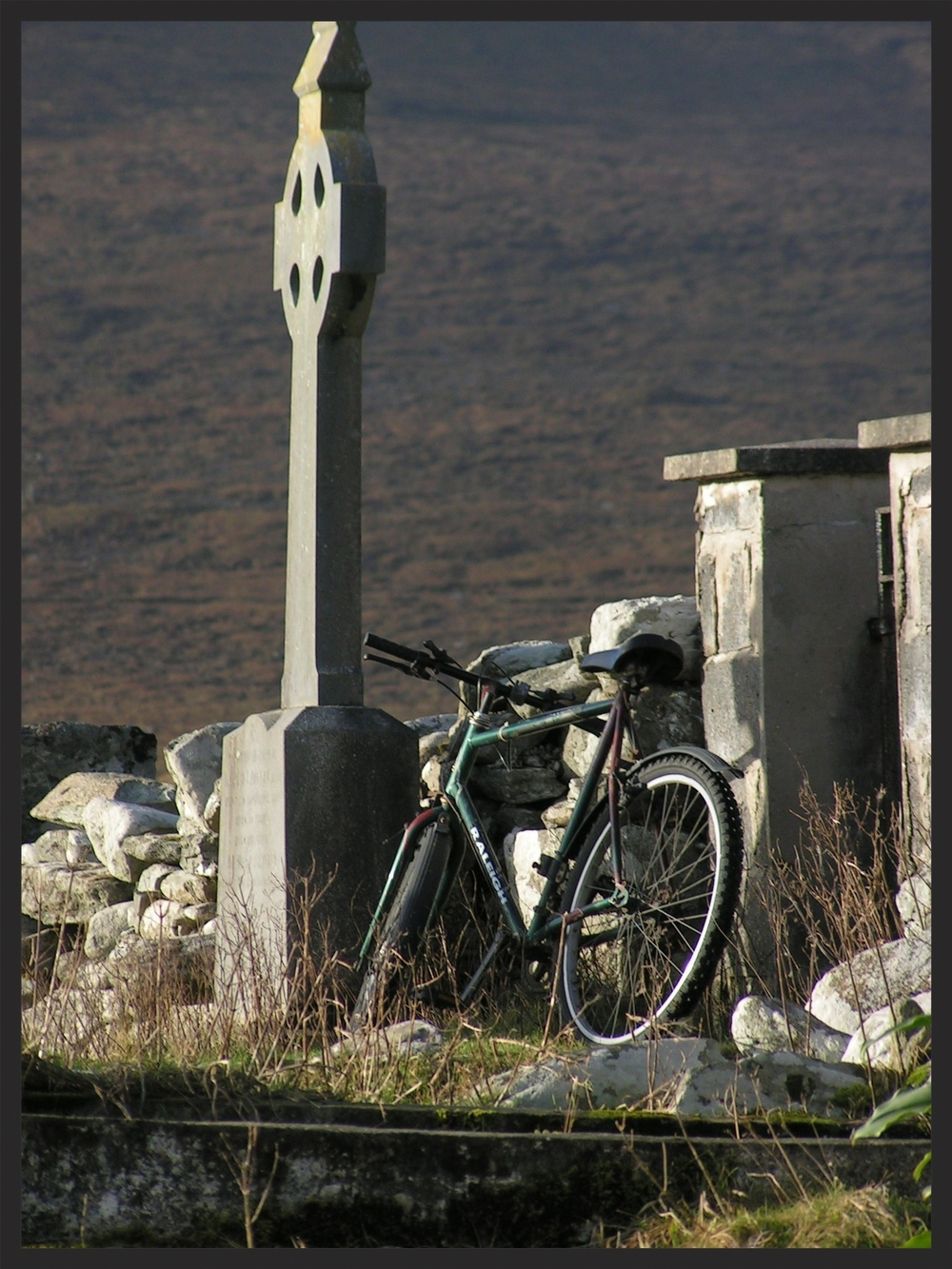 ACHILL GRAVEYARD WITH BIKE