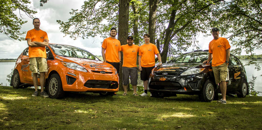From left: Danny Grant, Payton Gray, Chris Duplessis, Jackson Gray, Jeff Gray with their Kitty Smiles Rally Adventure Ford Fiesta Rally Cars. 2014 Ojibwe Forest Rally. Copyright Rally Ready Driving School