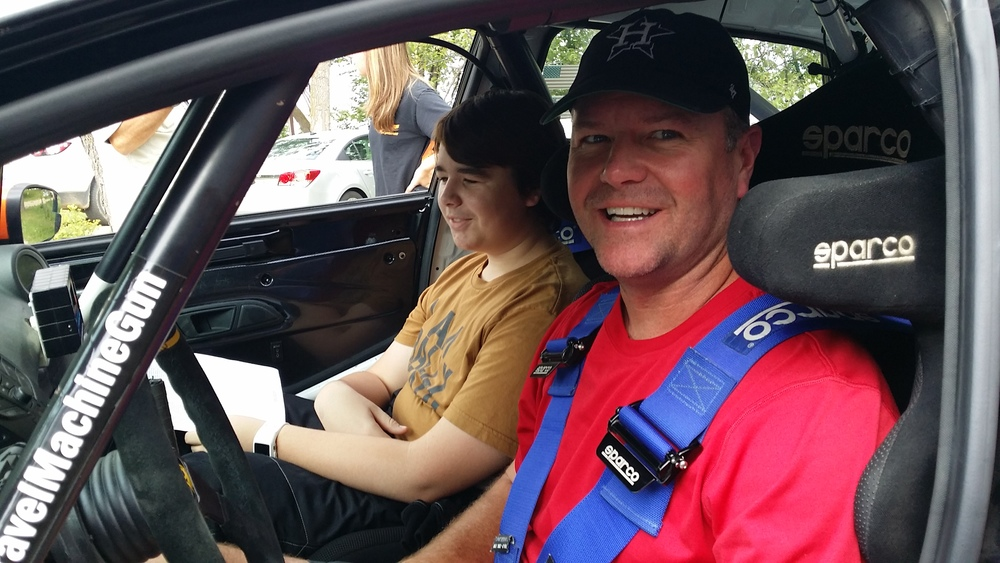 Jeff and Jackson excitedly waiting for the start of the 2014 Ojibwe Forest Rally. Copyright Rally Ready Driving School