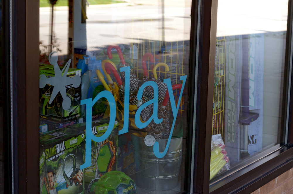 Play Logan Square Front Window