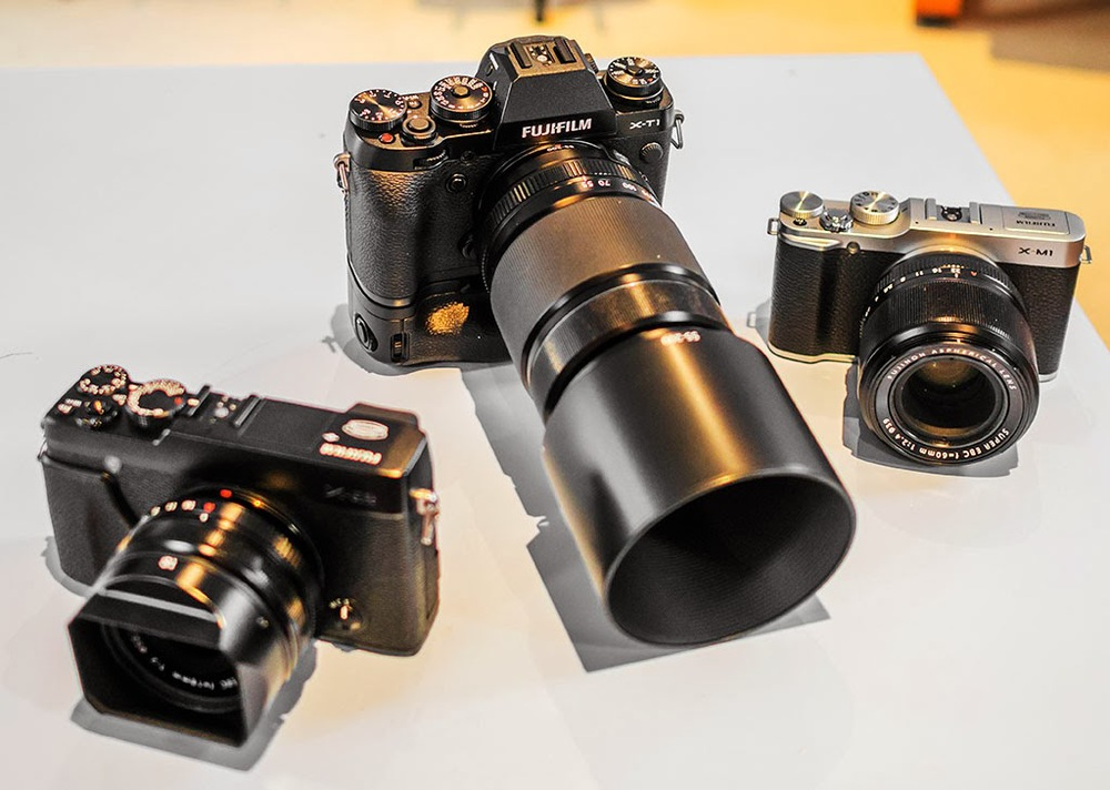 Fuji X-T1 + battery grip, Fuji X-M1 and Fuji X-E2 and 18mm f/2 lens.